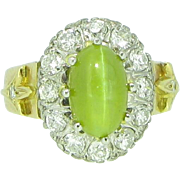 Stunning Cat's Eye Chrysoberyl, surrounded with diamonds, 18kt yellow gold