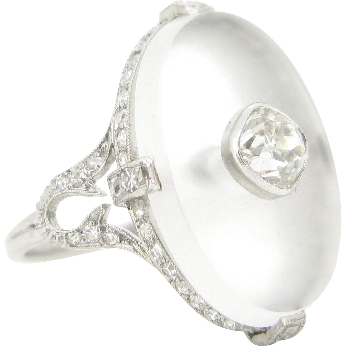 A rare ravishing platinum Art Deco ring adorned with rock crystal and diamonds