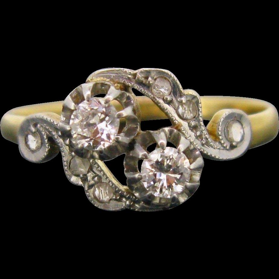 Antique Crossover diamonds ring, 18kt gold and platinum,c.1900