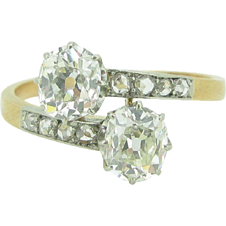 Antique Toi et Moi 2 diamonds ring / Bypass ring / Crossover ring, 18kt gold and platinum, c.1900