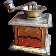 Tiny German tin coffee grinder