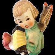 little Goebel Angel playing accordion