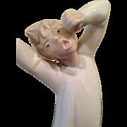 Mint Lladro Yawning and stretching boy