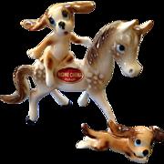 Unusual Miniature bone china dog riding pony