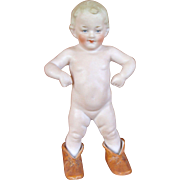 "Small Heubach Figurine ""Wearing Mommy's Shoes"""