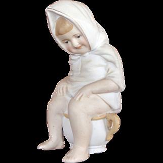 Bisque Girl on Potty Figurine