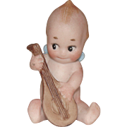 Little Bisque Kewpie Playing the Mandolin
