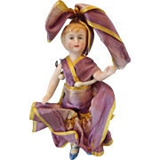 German All Bisque Doll with Ribbon Dress
