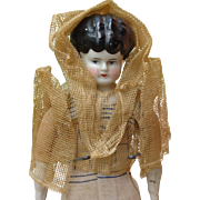 German China Head Doll Wearing Interesting Gown
