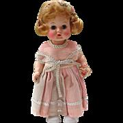 Little Miss Addie Hard Plastic Walking Doll