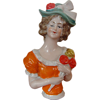 Colorful Half Doll Holding a Bouquet