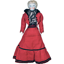 German China Head Doll Wearing a Red Wool Suit