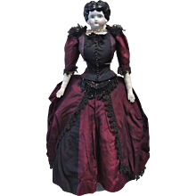 German China Head Doll Wearing a Gorgeous Silk Gown