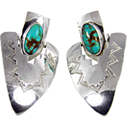 Hello and thank you for your interest in our inventory. Up for your consideration today is this par of handmade Sterling and Turquoise Dangle Earrings by Navajo Silversmith Marcella James.    Ref., American Indian Jewelry II: A-L 1800 Artist Biograph