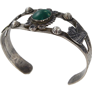 Navajo - Fred Harvey Era Sterling Silver with Green Turquoise Indian Head Cuff Bracelet C. 1930-40s.