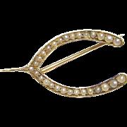 1900's Edwardian 14K Yellow Gold Natural Seed Pearl Wishbone Brooch
