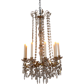 A nineteenth Century candle-lit chandelier