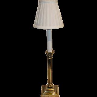A Victorian brass lamp