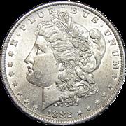1882-O/S Weak AU58 Morgan Dollar