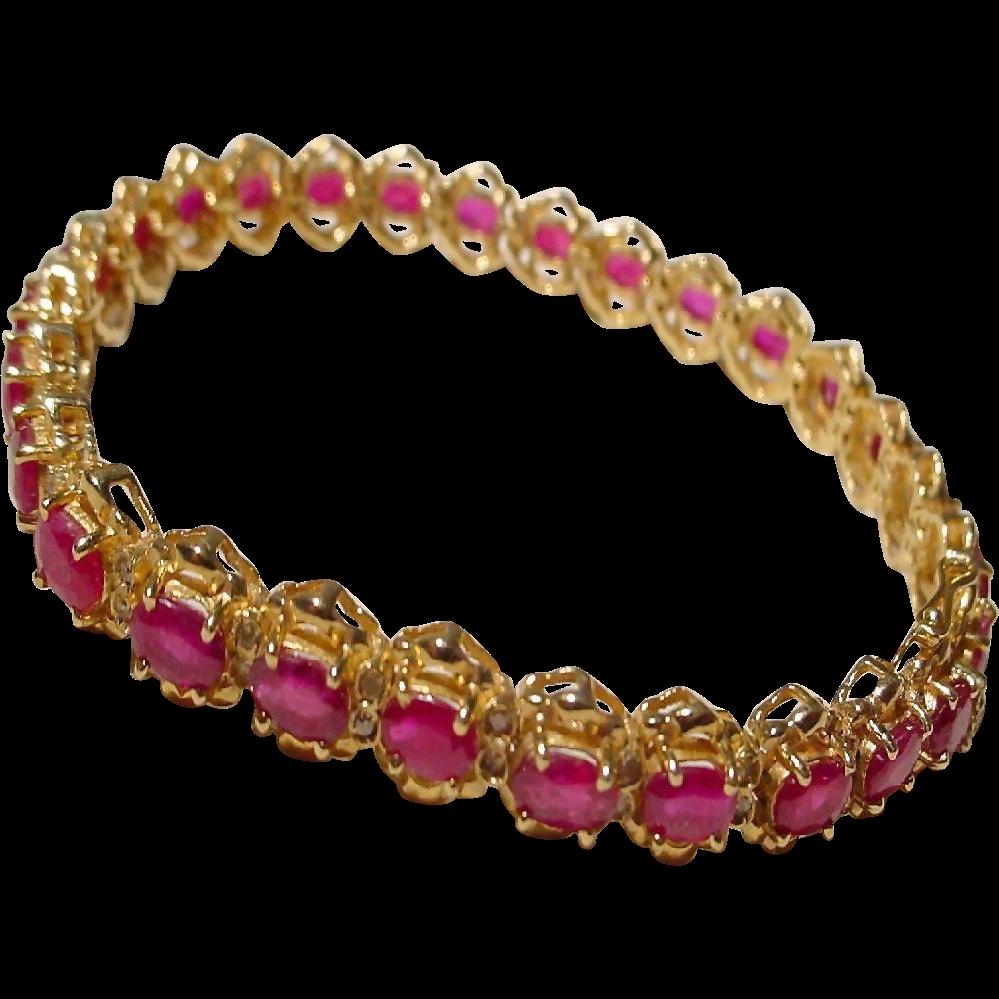supper red ruby bracelet w diamonds 14 kt ygold
