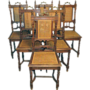 Set of 6 French Henry II Oak Chairs with cane seats,  Late 19th Century