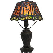 Handel Boudoir Sunset Palm Overlay Table Lamp Resting on a Swampy Base
