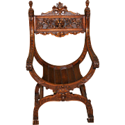 Antique French Renaissance Highly Carved Arm Chair in Walnut with Mythical Demons
