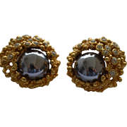 Vintage clip on gold tone hematitis and rhinestone earrings