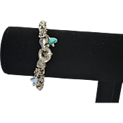 Vintage sterling silver woven chain bracelet with turquoise