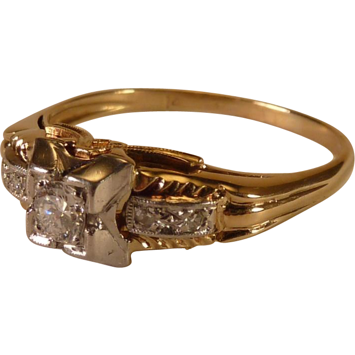 14 karat yellow and white gold engagement ring from louis