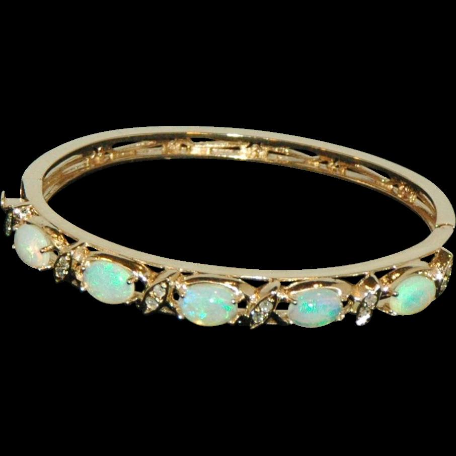14 karat yellow gold opal and set bangle