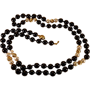 Black onyx, cultured pearl and fluted 14 Karat Gold bead necklace