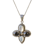 Vintage Southwestern Onyx and Mother of Pearl Sterling Silver Cross Pendant