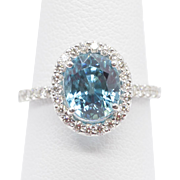 5.0ct Natural Blue Zircon and .85ct Diamond Halo Ring
