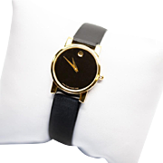 Lady's Movado Black and Gold Museum Dial Watch