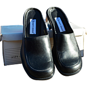 Women's Black Leather Slip- On, Open-Backed Shoe by Andre Assous