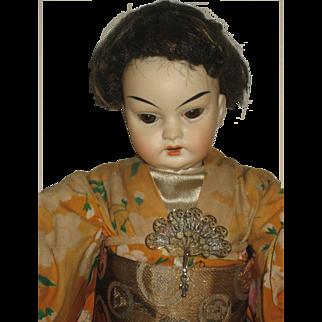 German Oriental Doll.cabinet size 12 inch