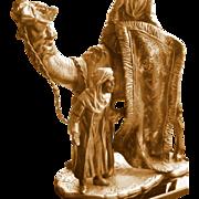 Orientalist Art - Lighter Match Striker - Group Scene: Traveling Rug Merchant on Camel with companion (D1)
