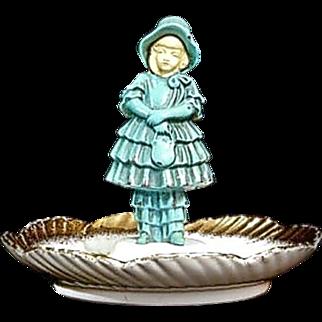 J.B. Hirsch Figural Pin Tray depicting a demure Chryselephantine Young Lady - D1