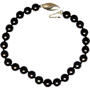 Vintage black freshwater pearl bracelet with solid 14kt gold clasp