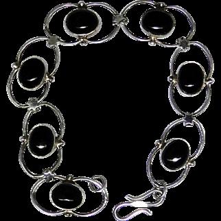 Sterling silver bracelet set with Black Onyx cabochons, lightly worn estate piece