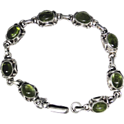 Vintage ornate sterling silver bracelet set with natural Peridot cabochon gemstones