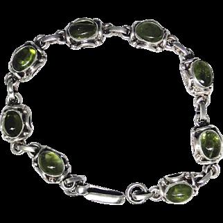 Vintage ornate sterling silver bracelet set with natural Peridot cabochon gemstones