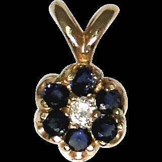 Vintage petite Sapphire and diamond pendant set in 14kt gold, flower design