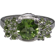 Sterling silver ornate ring set with good quality faceted Peridot gemstones, size: 7.25