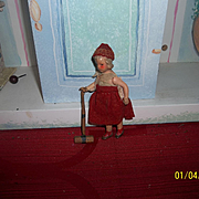 German Painted Bisque Dollhouse Doll with Croquet Mallet