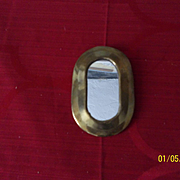 A Vintage Dollhouse Brass Mirror