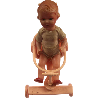 An Adorable Little Vintage Doll That Comes With Her Stroller