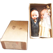 An Adorable Celluloid Kewpie Bride and Groom