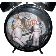 2 All Bisque German Dolls Sitting in a Clock Case - Red Tag Sale Item